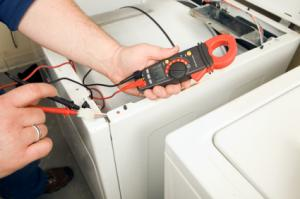 a Union City Handyman checks the electrical current to a washing machine